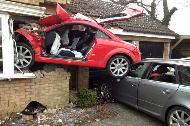 Red Audi TT that crashed into a house in uk-8