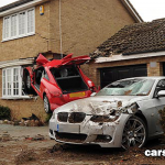 Audi TT flies and crashes into house